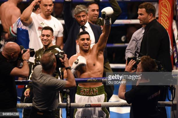 Britain's Amir Khan celebrates defeating Canada's Phil Lo Greco in their SuperWelterweight contest at the Echo Arena in Liverpool northern England on...
