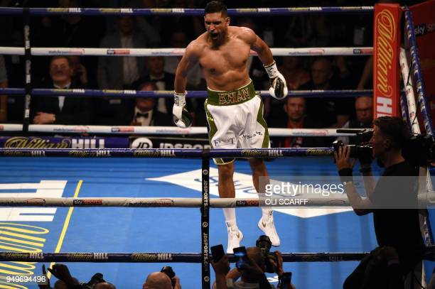 TOPSHOT Britain's Amir Khan celebrates defeating Canada's Phil Lo Greco in their SuperWelterweight contest at the Echo Arena in Liverpool northern...