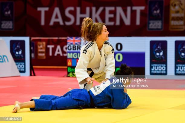 Britain's Amy Livesey celebrates over Mongolia's Gankhaich Bold during their women's -63kg bronze medal category combat at the Tashkent Grand Slam...