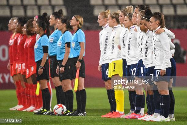 Britain's and Canada's team poses before the Tokyo 2020 Olympic Games women's group E first round football match between Canada and Britain at the...