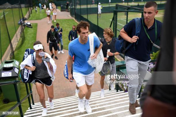 Britain's Andy Murray and Britain's Johanna Konta leave after attending a practice session at The All England Lawn Tennis Club in Wimbledon southwest...