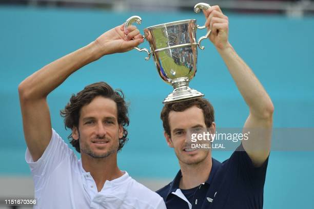 TOPSHOT Britain's Andy Murray and Spain's Feliciano Lopez pose with the trophy after their win in the men's doubles final tennis match against US...