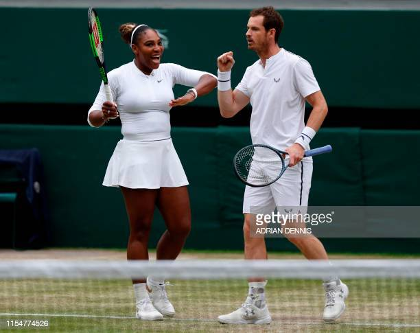 Britain's Andy Murray and US player Serena Williams celebrate winning a point against France's Fabrice Martin and US player Raquel Atawo during their...
