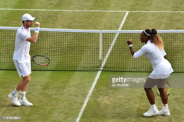 Britain's Andy Murray and US player Serena Williams celebrate winning a point against Brazil's Bruno Soares and US players Nicole Melichar during...