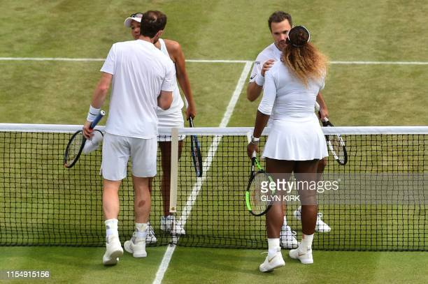 Britain's Andy Murray and US player Serena Williams congratulate toBrazil's Bruno Soares and US players Nicole Melichar during their mixed doubles...