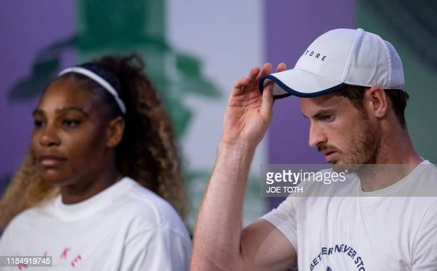 Britain's Andy Murray and US player Serena Williams give a press conference after losing against Brazil's Bruno Soares and US players Nicole Melichar...