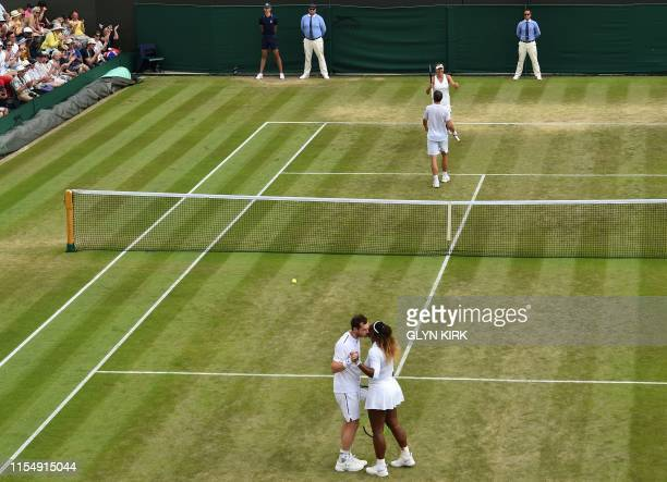 Britain's Andy Murray and US player Serena Williams greet each other as Brazil's Bruno Soares and US players Nicole Melichar celebrate their victory...