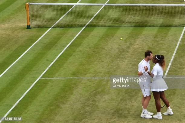 Britain's Andy Murray and US player Serena Williams greet each other after being beaten by Brazil's Bruno Soares and US players Nicole Melichar...