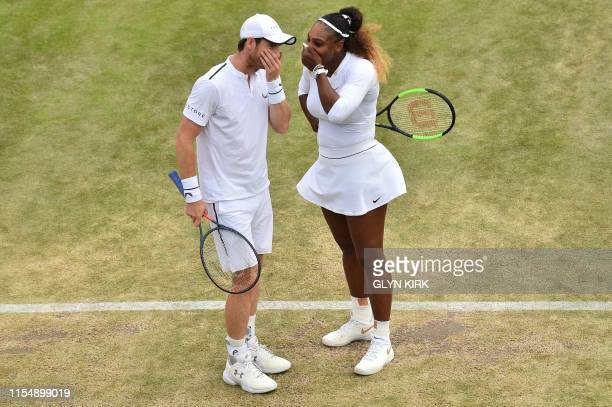 Britain's Andy Murray and US player Serena Williams talk as they play Brazil's Bruno Soares and US players Nicole Melichar during their mixed doubles...