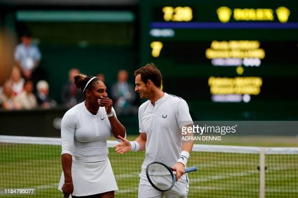 Britain's Andy Murray and US player Serena Williams talk between points against France's Fabrice Martin and US player Raquel Atawo during their mixed...