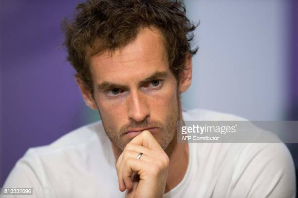 Britain's Andy Murray attends a press conference at The All England Tennis Club in Wimbledon southwest London on July 12 after losing his men's...