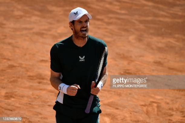 Britain's Andy Murray celebrates a point during his Men's double match with Britain's Liam Broady against Germany's Kevin Krawitz and Romania's Horia...