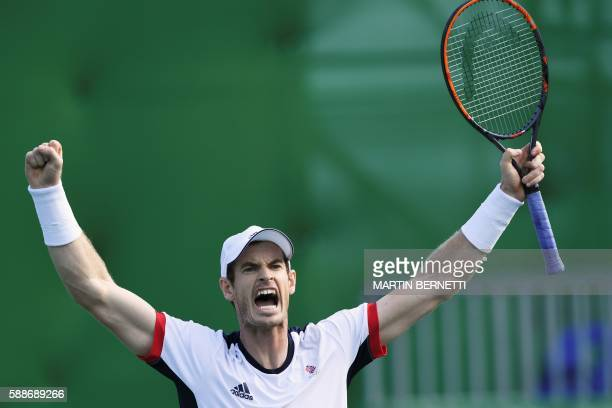 Britain's Andy Murray celebrates after winning his men's singles quarterfinals tennis match against US player Steve Johnson at the Olympic Tennis...