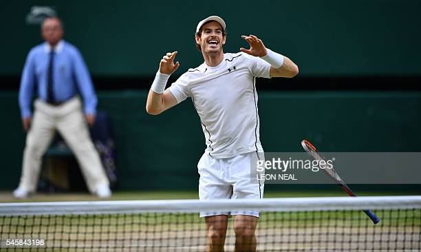 TOPSHOT Britain's Andy Murray celebrates beating Canada's Milos Raonic during the men's singles final match on the last day of the 2016 Wimbledon...