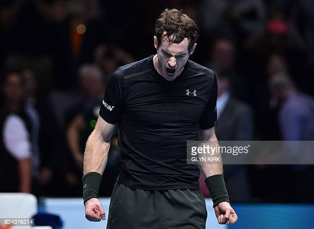 TOPSHOT Britain's Andy Murray celebrates beating Canada's Milos Raonic during their men's semifinal singles match on day seven of the ATP World Tour...