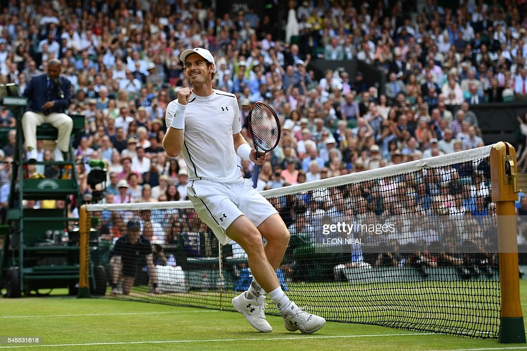 Britain's Andy Murray celebrates beating Czech Republic's Tomas Berdych in their men's singles semi-final match on the twelfth day of the 2016 Wimbledon Championships at The All England Lawn Tennis Club in Wimbledon, southwest London, on July 8, 2016. / AFP / LEON