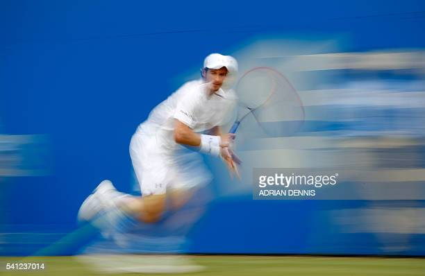 TOPSHOT Britain's Andy Murray celebrates returns to Canada's Milos Raonic during their men's singles final match at the ATP Aegon Championships...
