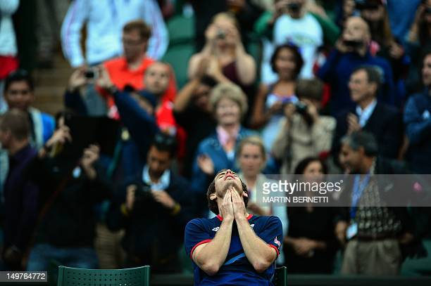 Britain's Andy Murray celebrates victory during his men's singles semifinal round match against Serbian's Novak Djokovicat during the 2012 London...