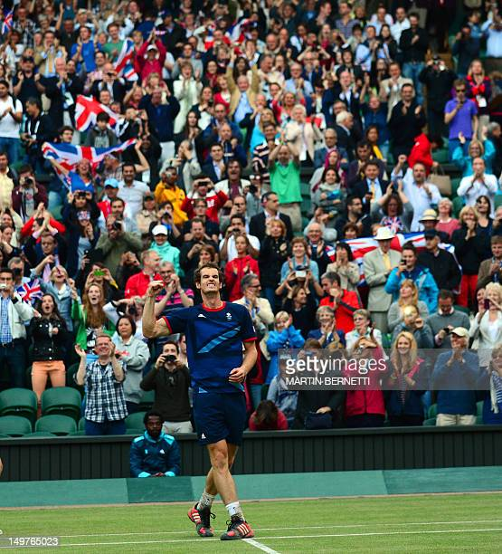 Britain's Andy Murray celebrates victory during his men's singles semifinal round match against Serbian's Novak Djokovic at the 2012 London Olympic...