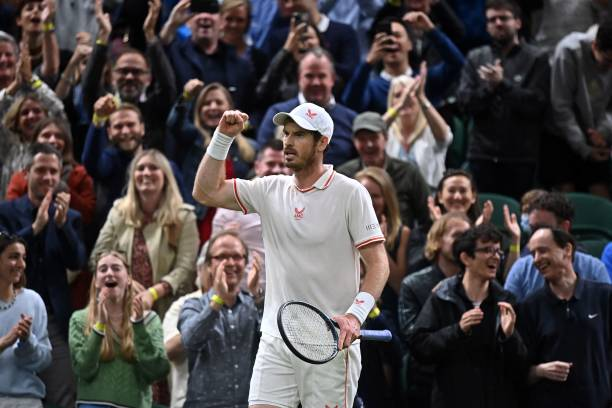 Britain's Andy Murray celebrates winning a game to go up 5-2 in the fifth set against Germany's Oscar Otte during their men's singles second round...