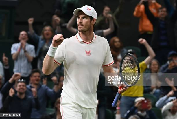 Britain's Andy Murray celebrates winning against Georgia's Nikoloz Basilashvili during their men's singles first round match on the first day of the...