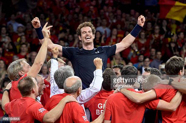 Britain's Andy Murray celebrates with teammates after winning his tennis match against Belgium's David Goffin to win the Davis Cup final between...