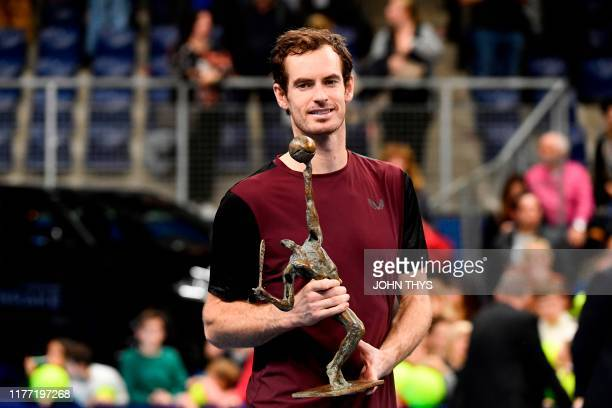 Britain's Andy Murray celebrates with the trophy after winning against Switzerland's Stanislas Wawrinka in their men's single tennis final match of...