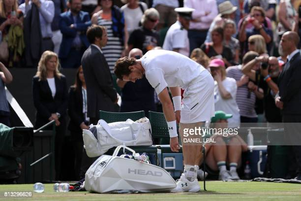 Britain's Andy Murray collects his things after losing against US player Sam Querrey in their men's singles quarterfinal match on the ninth day of...