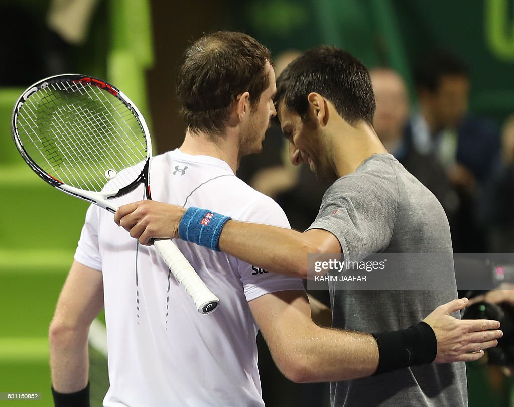 Britain's Andy Murray (R) congratulates Serbia's Novak Djokovic on winning during their final tennis match at the ATP Qatar Open in Doha on January 7, 2017. / AFP / KARIM