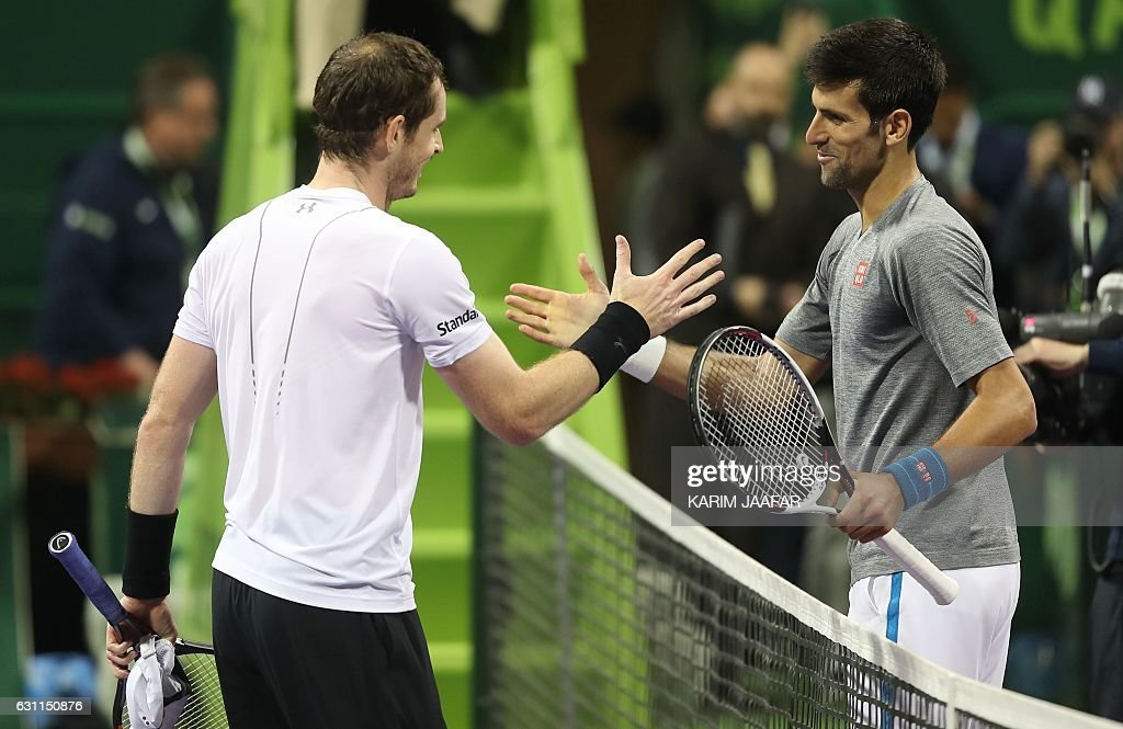 Britain's Andy Murray (L) congratulates Serbia's Novak Djokovic on winning during their final tennis match at the ATP Qatar Open in Doha on January 7, 2017. / AFP / KARIM