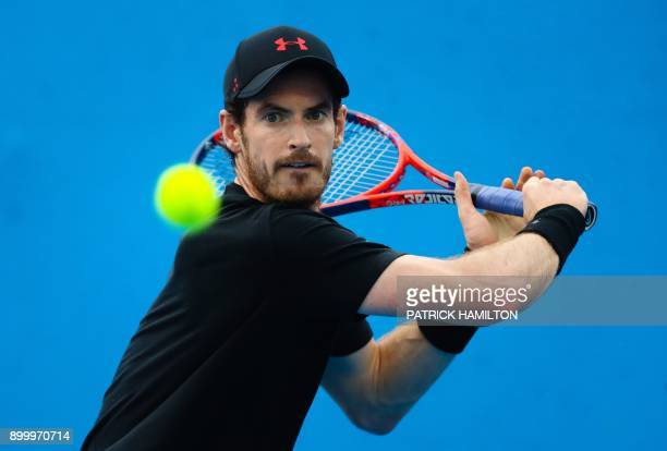 TOPSHOT Britain's Andy Murray hits a return during training for his first round men's singles match at the Brisbane International tennis tournament...