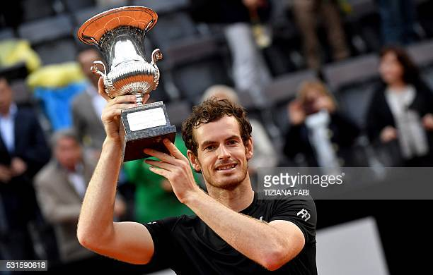 TOPSHOT Britain's Andy Murray holds his trophy after winning the men's final match against Novak Djokovic of Serbia at the ATP Tennis Open on May 15...