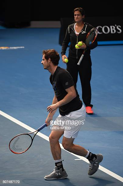 Britain's Andy Murray is watched by his coach Amelie Mauresmo as he takes part in a training session on day thirteen of the 2016 Australian Open...