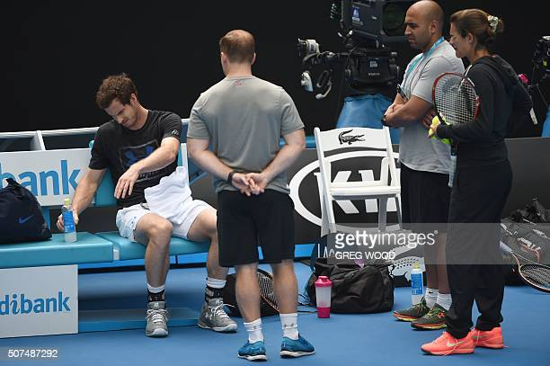 Britain's Andy Murray is watched by his team including coach Amelie Mauresmo as he takes part in a training session on day thirteen of the 2016...