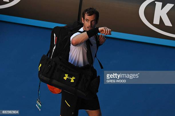 Britain's Andy Murray leaves the court following his defeat against Germany's Mischa Zverev during their men's singles fourth round match on day...