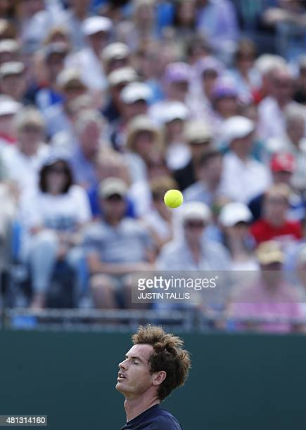 Britain's Andy Murray misses a return to France's Gilles Simon during a Davis Cup world group quarterfinals singles tennis match at the Queen's Club...