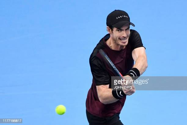 Britain's Andy Murray plays a backhand return to Switzerland's Stanislas Wawrinka during their men's single tennis final match of the European Open...
