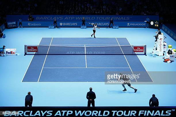 Britain's Andy Murray plays against Switzerland's Stan Wawrinka during their round robin stage men's singles match on day six of the ATP World Tour...