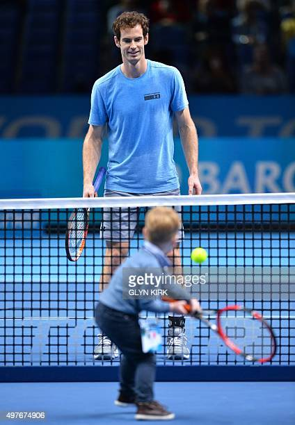 Britain's Andy Murray plays tennis with Ashley Goodchild a young boy who was diagnosed with liver cancer in 2012 on day four of the ATP World Tour...