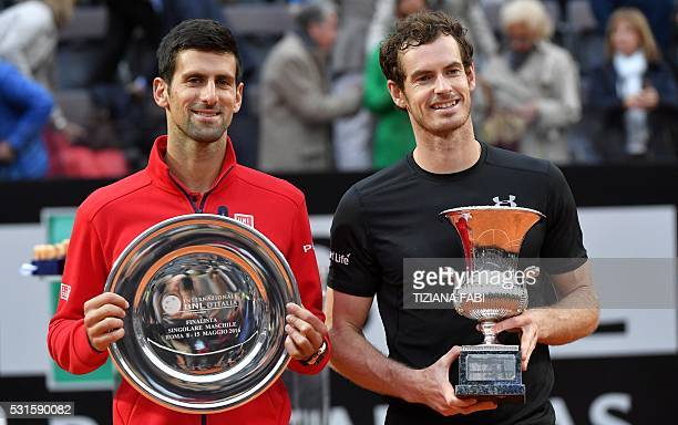 Britain's Andy Murray poses next to Novak Djokovic of Serbia after after winning the men's final match at the ATP Tennis Open on May 15 2016 at the...