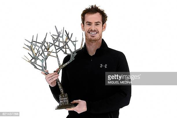 Britain's Andy Murray poses with his trophy after winning the final tennis match against USA's John Isner at the ATP World Tour Masters 1000 indoor...