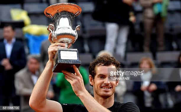 Britain's Andy Murray poses with his trophy after winning the men's final match against Novak Djokovic of Serbia at the ATP Tennis Open on May 15...