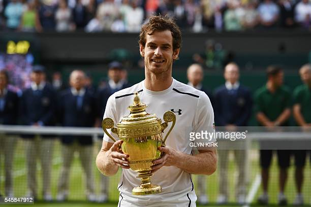 Britain's Andy Murray poses with the winner's trophy after his men's singles final victory over Canada's Milos Raonic on the last day of the 2016...