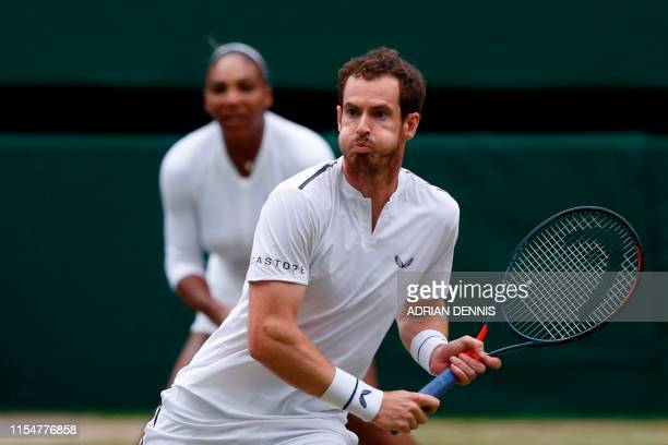 Britain's Andy Murray prepare to return as US player Serena Williams covers the baseline against France's Fabrice Martin and US player Raquel Atawo...