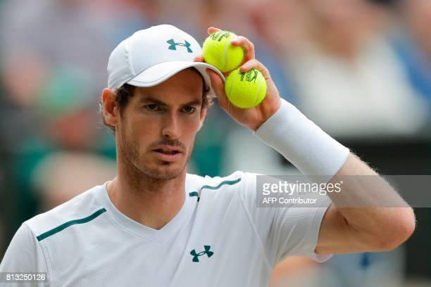 Britain's Andy Murray prepares to serve against US player Sam Querrey during their men's singles quarterfinal match on the ninth day of the 2017...