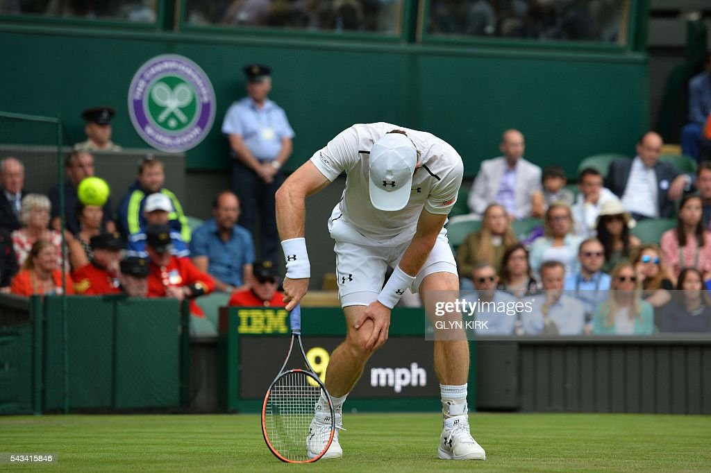 TOPSHOT - Britain's Andy Murray reacts after a point against Britain's Liam Broady during their men's singles first round match on the second day of the 2016 Wimbledon Championships at The All England Lawn Tennis Club in Wimbledon, southwest London, on June 28, 2016. / AFP / GLYN