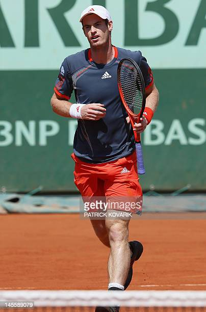 Britain's Andy Murray reacts after a point against Colombia's Santiago Giraldo during their Men's Singles third Round tennis match of the French Open...
