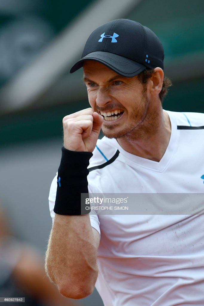 Britain's Andy Murray reacts after a point against Russia's Karen Khachanov during their tennis match at the Roland Garros 2017 French Open on June 5, 2017 in Paris. /