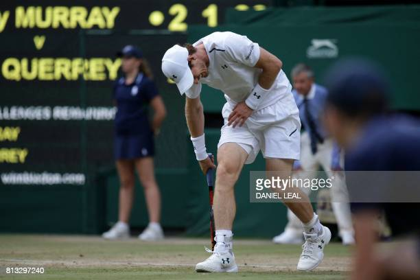 Britain's Andy Murray reacts after a point against US player Sam Querrey in their men's singles quarterfinal match on the ninth day of the 2017...