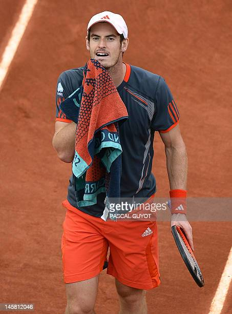 Britain's Andy Murray reacts after a point as he plays against Spain's David Ferrer during their men's quarterfinal tennis match of the French Open...